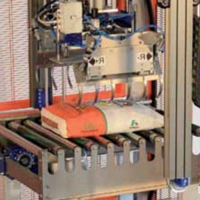 Механический захват для подъема мешков для паллетайзера